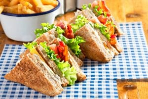 Bacon lettuce tomato sandwich with spring onion mayo and fries